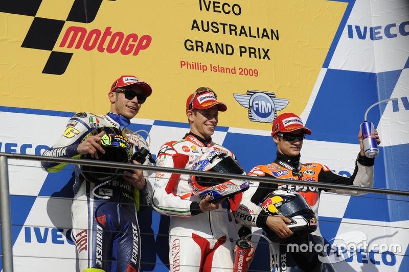 Podium: second place Valentino Rossi, Yamaha; Race winner Casey Stoner, Ducati; third place Dani Pedrosa, Repsol Honda