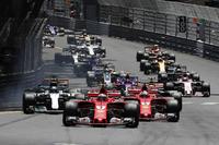 Kimi Raikkonen, Ferrari SF70-H leads Sebastian Vettel, Ferrari SF70-H at the start of the race