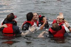 The McLaren raft team celebrate victory