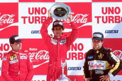 Podium: race winner Alain Prost, McLaren TAG Porsche, second place Michele Alboreto, Ferrari, third place Elio de Angelis, Lotus Renault