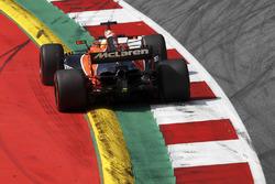 Fernando Alonso, McLaren MCL32, runs wide over a kerb