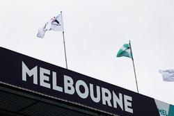 Flags fly above the pit lane