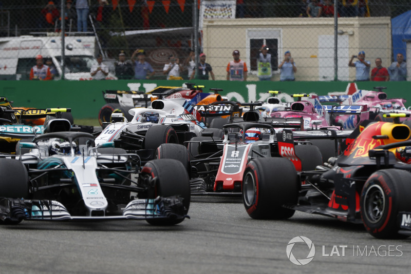 Max Verstappen, Red Bull Racing RB14, leads Valtteri Bottas, Mercedes AMG F1 W09, and Romain Grosjean, Haas F1 Team VF-18