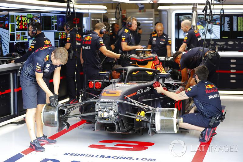 Red Bull team members work on the Daniel Ricciardo Red Bull Racing RB14