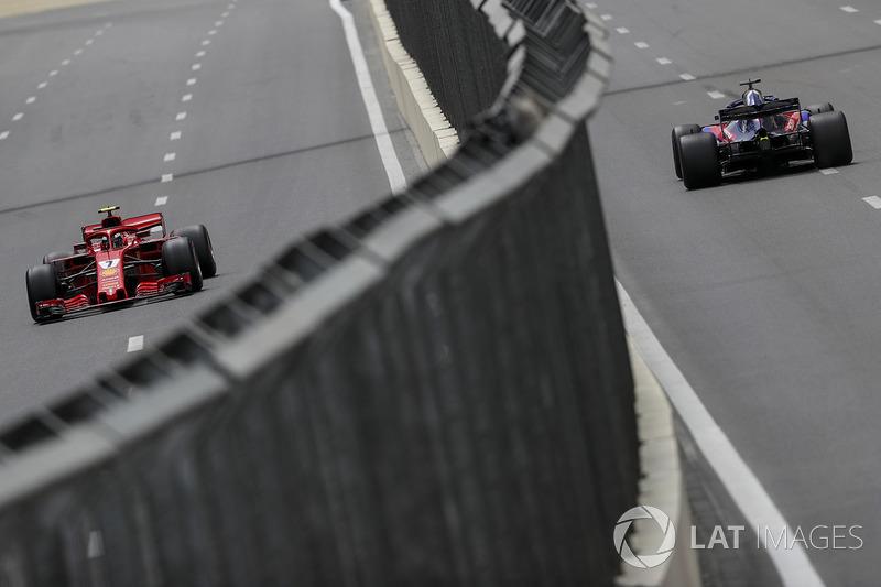 Kimi Raikkonen, Ferrari SF71H and Brendon Hartley, Scuderia Toro Rosso STR13
