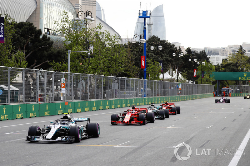 Valtteri Bottas, Mercedes AMG F1 W09, leads Sebastian Vettel, Ferrari SF71H, Lewis Hamilton, Mercedes AMG F1 W09, and Kimi Raikkonen, Ferrari SF71H at the restart