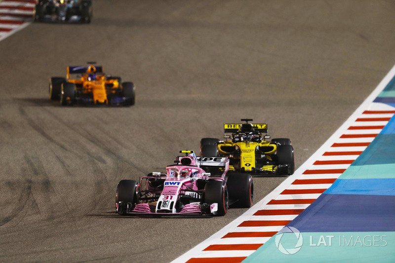 Esteban Ocon, Force India VJM11 Mercedes, leads Nico Hulkenberg, Renault Sport F1 Team R.S. 18, and
