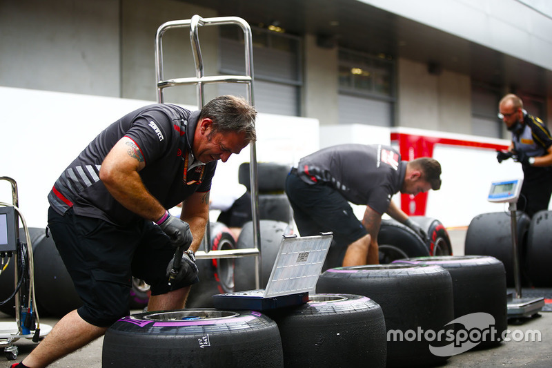 Haas engineers work on some tyres