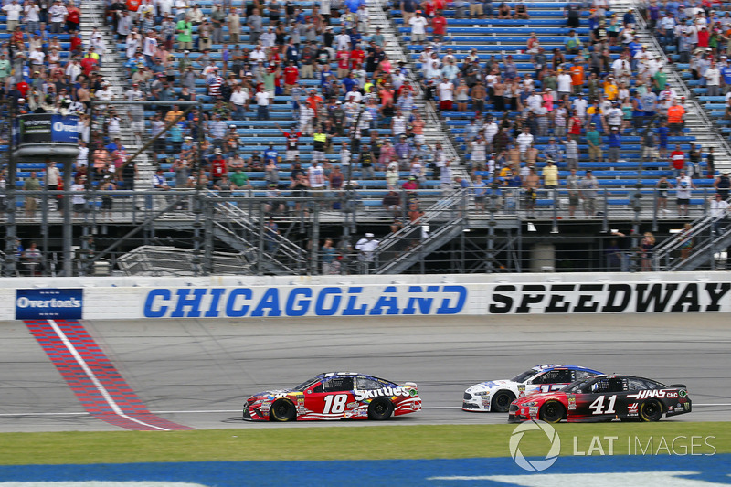 Kyle Busch, Joe Gibbs Racing, Toyota Camry Skittles Red White & Blue drives under the checkered flag to win