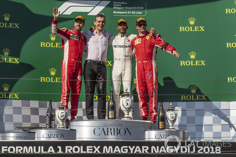 Sebastian Vettel, Ferrari, Lewis Hamilton, Mercedes-AMG F1 y Kimi Raikkonen, Ferrari en el podio del GP de Hungría