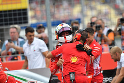 Pole sitter Sebastian Vettel, Ferrari celebrates in parc ferme with engineer