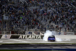 Brett Moffitt, Hattori Racing Enterprises, AISIN Atlanta Toyota Tundra celebrates with a burn out