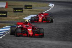 Kimi Raikkonen, Ferrari SF71H leads Sebastian Vettel, Ferrari SF71H