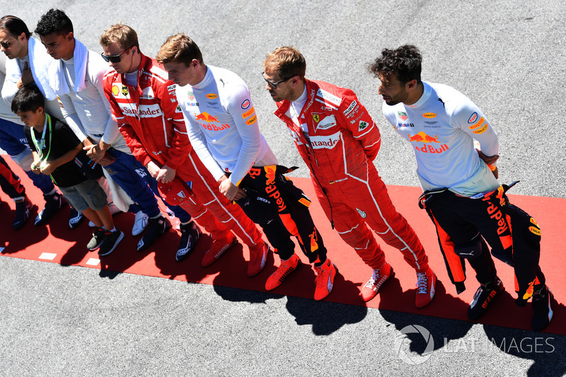 Drivers observe the National Anthem