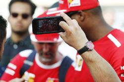 A fan takes a selfie with Sebastian Vettel, Ferrari, and Kimi Raikkonen, Ferrari