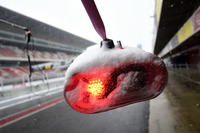 Ferrari pit stop lights as snow stops testing on day three