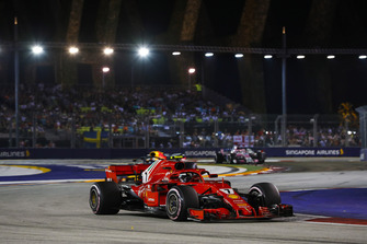 Kimi Raikkonen, Ferrari SF71H, leads Daniel Ricciardo, Red Bull Racing RB14