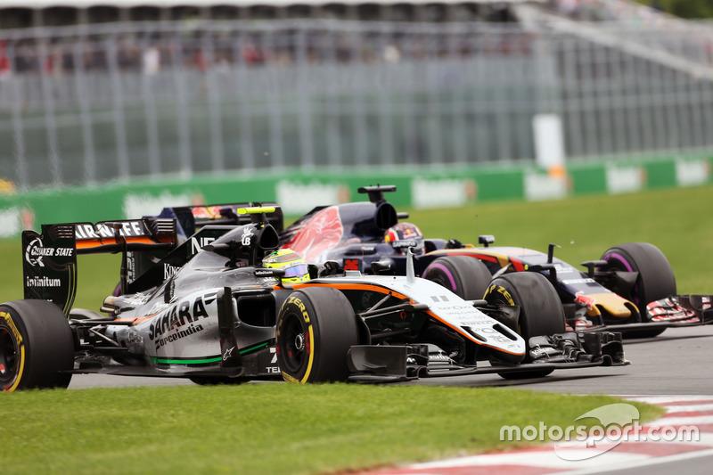 Серхіо Перес, Sahara Force India F1 VJM09 та Данііл Квят, Scuderia Toro Rosso STR11 боротьба за позицію