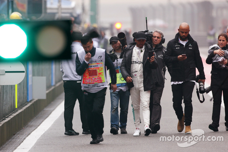 Lewis Hamilton, Mercedes AMG, takes to the track to entertain the fans