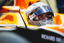 Fernando Alonso, McLaren, in cockpit with helmet visor raised