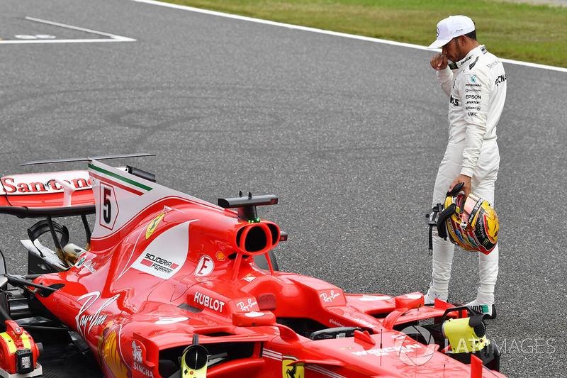 Lewis Hamilton, Mercedes AMG F1 looks at the Ferrari SF70H in parc ferme