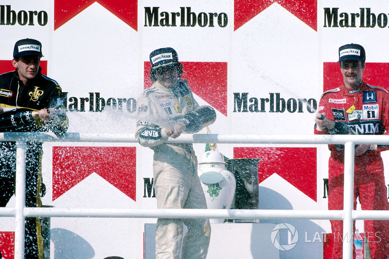 Podium: Race winner Nelson Piquet, Williams, second place Ayrton Senna, Lotus, third place Nigel Man