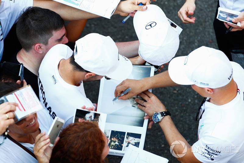 Valtteri Bottas, Mercedes AMG F1, signs autographs