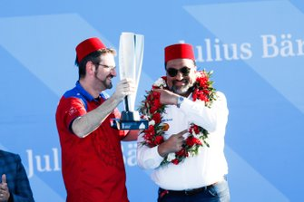 Dilbagh Gill, CEO, Team Principal, Mahindra Racing, celebrates with the constructors trophy on the podium