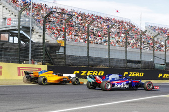 Fernando Alonso, McLaren MCL33, runs off the track behind Brendon Hartley, Toro Rosso STR13