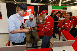 Owen Wilson and Woody Harrelson receive a tour of the Ferrari garage from Sergio Marchionne, Chief Executive Officer, Fiat Chrysler and Chairman, Ferrari. Gene