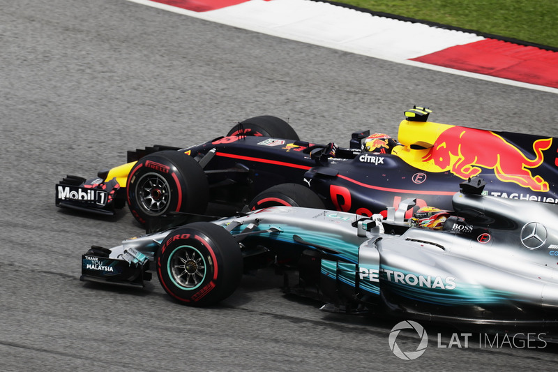 Max Verstappen, Red Bull Racing RB13, passes Lewis Hamilton, Mercedes F1 W08