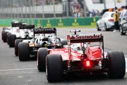 Sebastian Vettel, Ferrari SF16-H joins the queue at the pit lane exit