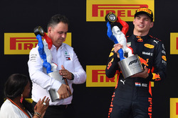 Max Verstappen, Red Bull Racing celebrates on the podium with the trophy