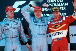 Podium: race winner Mika Hakkinen, McLaren, second place David Coulthard, McLaren, third place Heinz