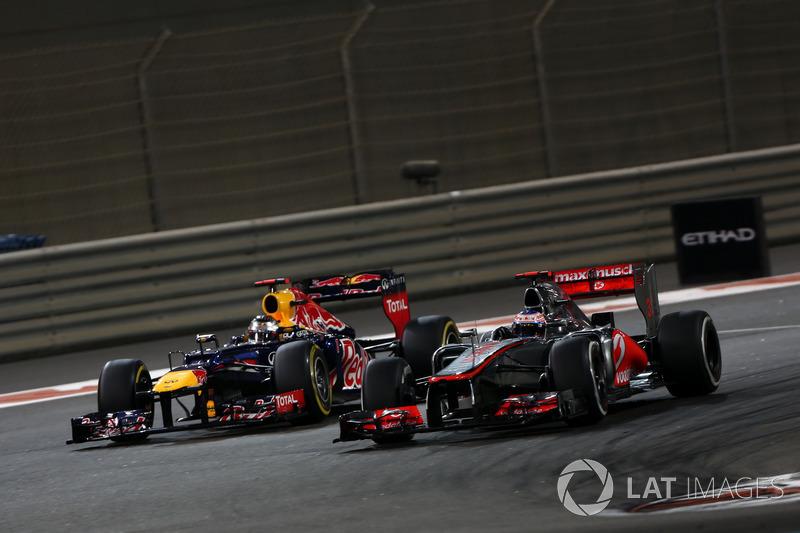 Jenson Button, McLaren MP4-27, leads Sebastian Vettel, Red Bull RB8