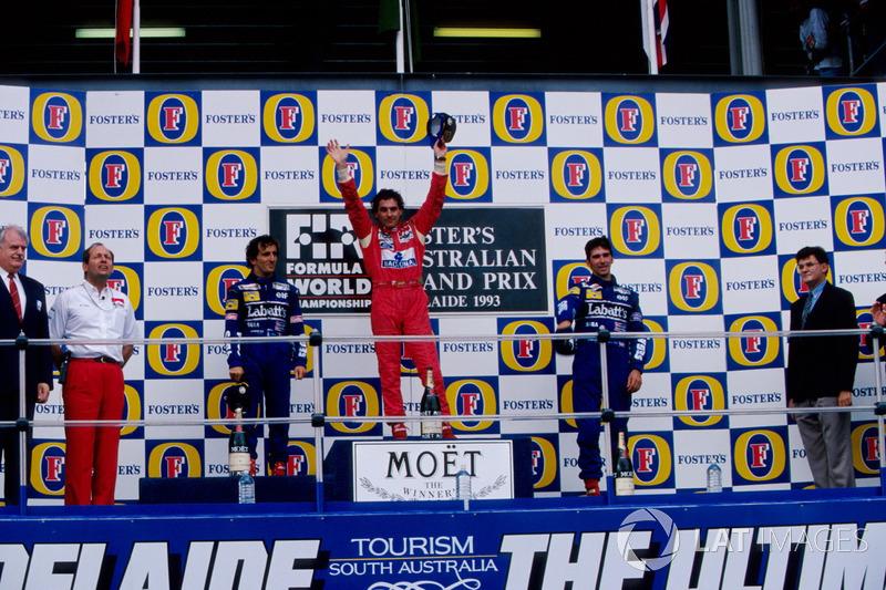 Podium: second place Alain Prost, Williams, Race winner Ayrton Senna, McLaren, third place Damon Hill, Williams