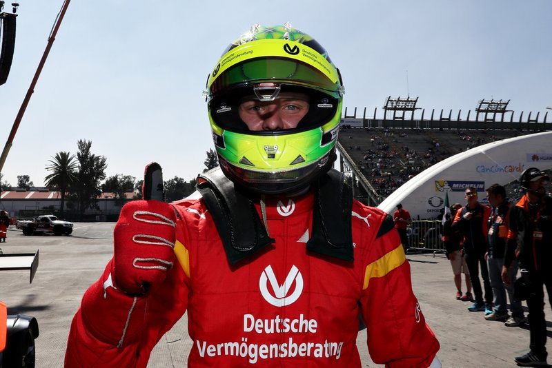 Mick Schumacher celebrates winning in the qualifying round