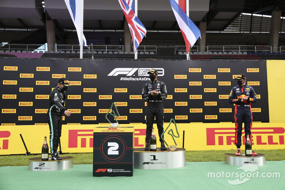 Valtteri Bottas, Mercedes-AMG Petronas F1 celebrates on the podium with the trophy with Race winner Lewis Hamilton, Mercedes-AMG Petronas F1 anDrivers Max Verstappen, Red Bull Racing