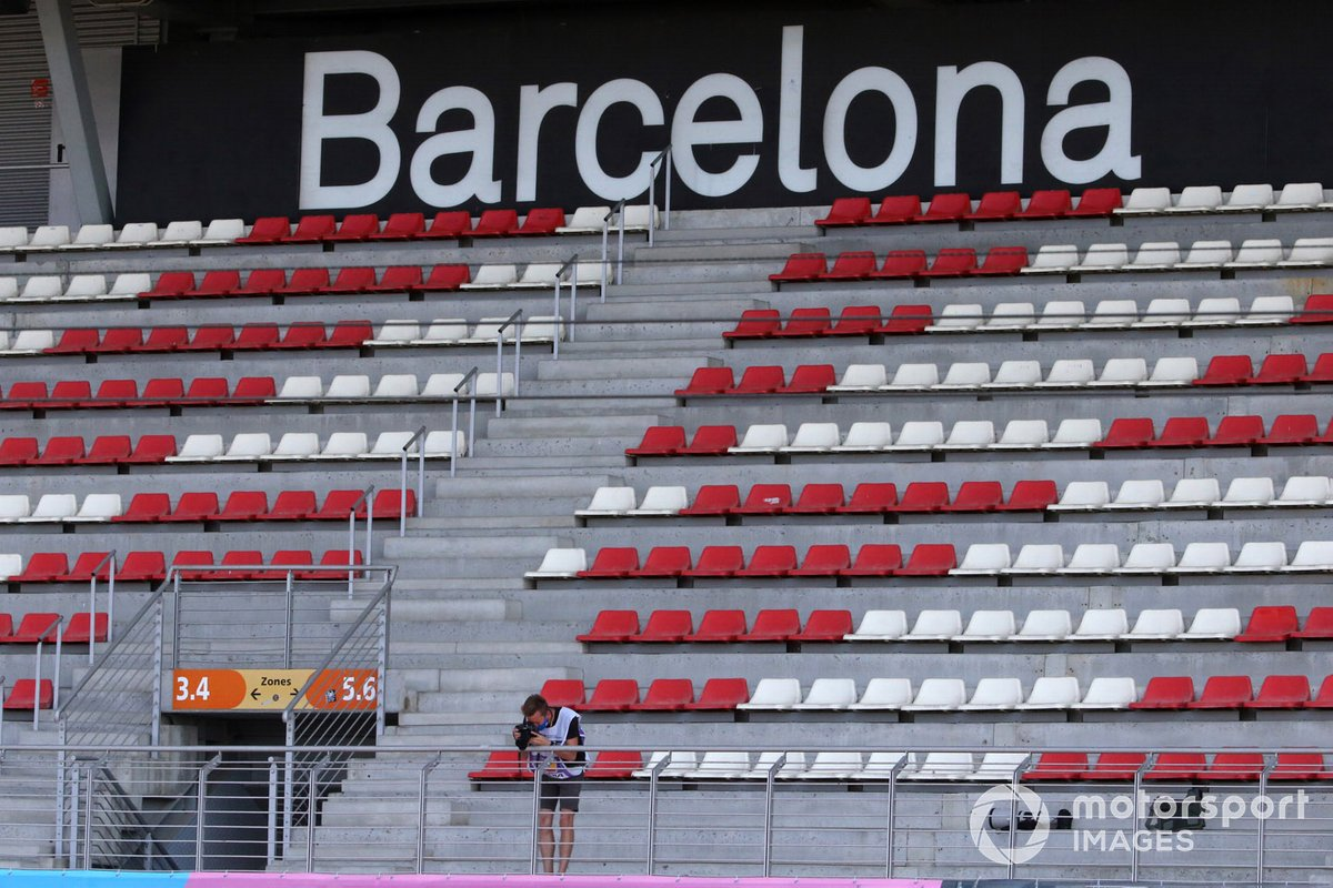 A photographer in an empty grandstand