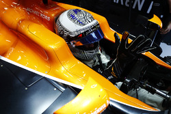 Fernando Alonso, McLaren, puts on his gloves in his cockpit