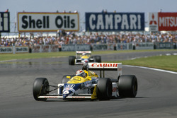 Nelson Piquet, Williams FW11B, leads Nigel Mansell, Williams FW11B