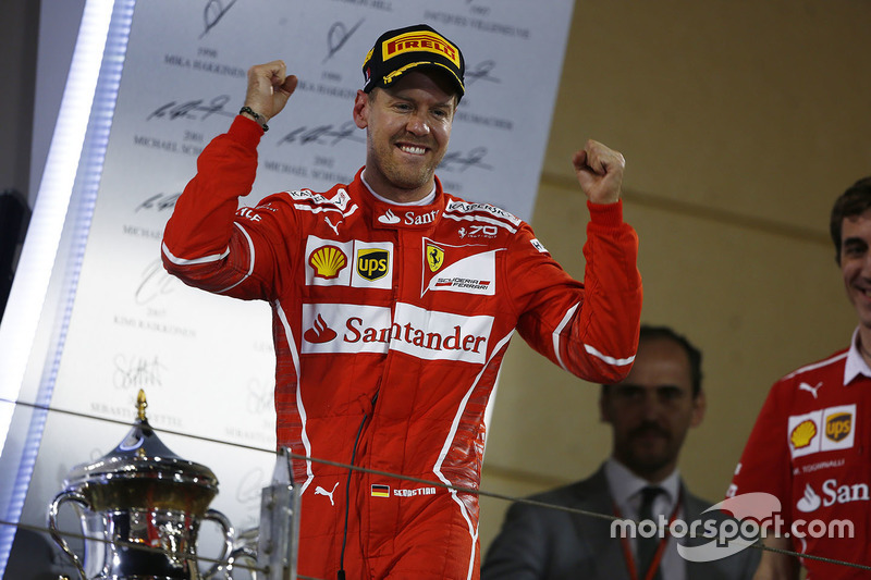 Подиум: победитель Себастьян Феттель, Ferrari