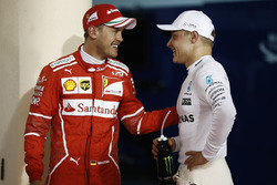 Temporada 2017 F1-bahrain-gp-2017-polesitter-valtteri-bottas-mercedes-amg-third-place-sebastian-vettel-fe