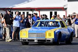 Dale Earnhardt Jr. with Dale Earnhardt's rookie car