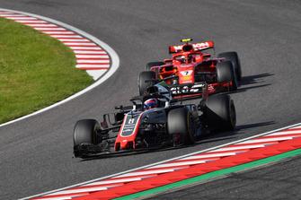 Romain Grosjean, Haas F1 Team VF-18 leads Kimi Raikkonen, Ferrari SF71H
