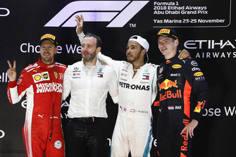 Sebastian Vettel, Ferrari, 2nd position, Bradley Lord, Communications Director, Mercedes AMG, Lewis Hamilton, Mercedes AMG F1, 1st position, and Max Verstappen, Red Bull Racing, 3rd position, on the podium