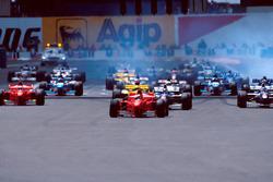 Start action, Michael Schumacher, Ferrari F310B leads