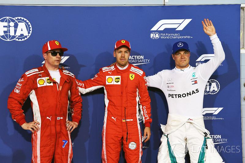 Kimi Raikkonen, Ferrari, pole sitter Sebastian Vettel, Ferrari and Valtteri Bottas, Mercedes-AMG F1 celebrate in parc ferme