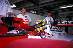 Josef Leberer, McLaren Physio keeps an eye on Ayrton Senna, McLaren as he sits in the cockpit of his car