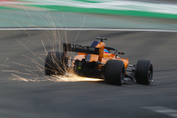 Sparks fly from the car of Fernando Alonso, McLaren MCL33 Renault